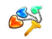 Key with 3 trinket-hearts — Stock Photo