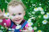 Baby on the meadow — Stock Photo