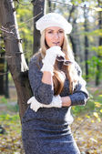 Beautiful glamour women in white cap and gloves — Stock Photo