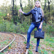 Fall woman on a railroad — Stock Photo
