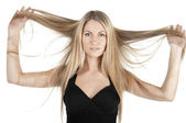 Woman holding long hair — Stock Photo