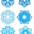 Vector snowflake on a black background — Stock Vector
