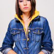 Lovely girl in a blue denim jacket — Stock Photo #7636332