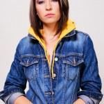 Lovely girl in a blue denim jacket — Stock Photo #7636332
