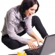Expressive laughing girl with laptop — Stock Photo