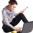 Lovely cheerful girl is surfing with laptop — Stock Photo