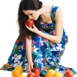 Stock Photo: Beautiful brunette gathering fresh fruits