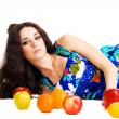 Beautiful woman resting with fresh fruits — Stock Photo
