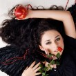 Stock Photo: Beautiful angel with red apple and rose