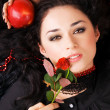 Beautiful romantic woman with a red apple and rose — Stock Photo