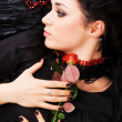 Beautiful romantic woman with a red rose — Stock Photo