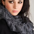 Beautiful brunette in gray scarf — Stock Photo