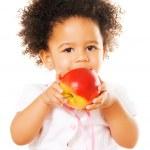 Pretty little girl holding an apple — Stock Photo