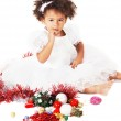 Lovely little girl playing with Christmas toys — Stock Photo