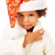 Lovely baby in Christmas hat and fur — Stock Photo #7636804