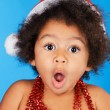 Surprised little child in Christmas hat — Stok fotoğraf