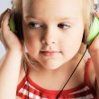 Little girl listening a music — Stock Photo