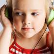 Little girl listening a music - Stock Photo