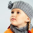 Llittle girl in warm clothes — Stock Photo