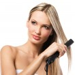 Young beautiful girl making hairstyle with hair iron — Stock Photo #7639767