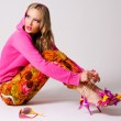 Pretty stylish woman in colorful clothing — Stock Photo #7639899