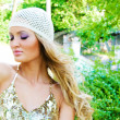 Pretty serene fashionable woman in the park — Stock Photo