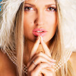 Pretty woman in a white fur hood — Stock Photo #7639940