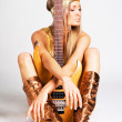 Golden girl with electric guitar — Stock Photo #7639976