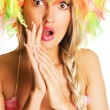 Surprised woman in funny colorful hat — Stock Photo