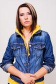 Lovely girl in a blue denim jacket — Stock Photo