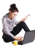Lovely cheerful girl is surfing with laptop — Стоковое фото