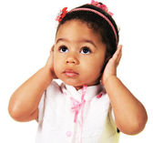 Cute little girl shutting dawn her ears — Stockfoto