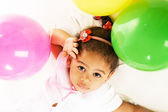 Pretty little girl with colorful balloons — Stock Photo