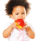 Pretty little girl holding an apple — Stock Photo