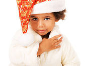 Lovely baby in Christmas hat and fur — Stock Photo