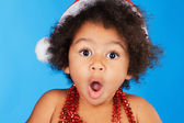 Surprised little child in Christmas hat — Stock Photo