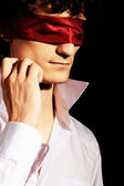 Romantic portrait of a handsome blindfold man — Stock Photo