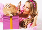 Lovely festive woman with a rabbit — Stock Photo