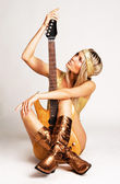 Golden girl with electric guitar — Stock Photo