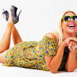 Beautiful cheerful blonde in green sunglasses - Stock Photo