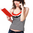 Cute student girl with a red book - Stock Photo