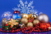 Christmas toys on blue background with snowflake — Stock Photo