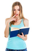 Lovely confused girl reading a book — Stock Photo
