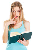 Lovely confused girl with a book — Stock Photo