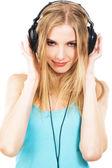 Lovely girl listening a music in headphones — Stock Photo