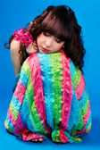 Cute brunette in colorful dress is sleeping — Stock Photo