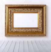 Old picture frame on a wall — Stockfoto