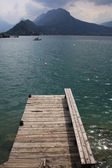 View from a wooden jetty over Lake Annecy — Stock Photo
