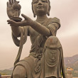 Stock Photo: Statue in front of Buddhin Hong Kong