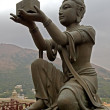 Statue in front of Buddha in Hong Kong — Stock Photo